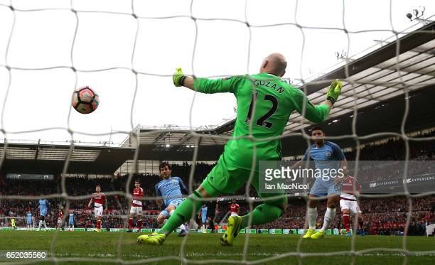 David Silva of Manchester City scores his sides first goal past Brad Guzan of Middlesbrough during The Emirates FA Cup QuarterFinal match between...