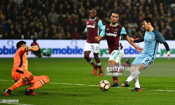 David Silva of Manchester City scores his sides third goal during The Emirates FA Cup Third Round match between West Ham United and Manchester City...