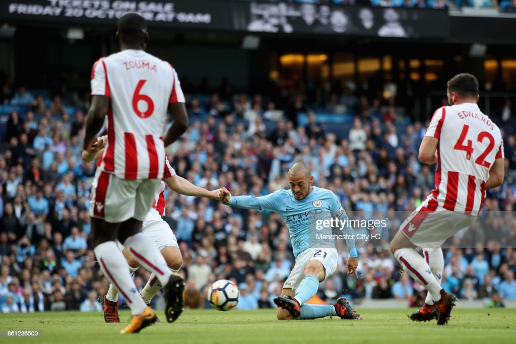 David Silva of Manchester City scores his sides third goal during the Premier League match between Manchester City and Stoke City at Etihad Stadium on October 14, 2017 in Manchester, England.