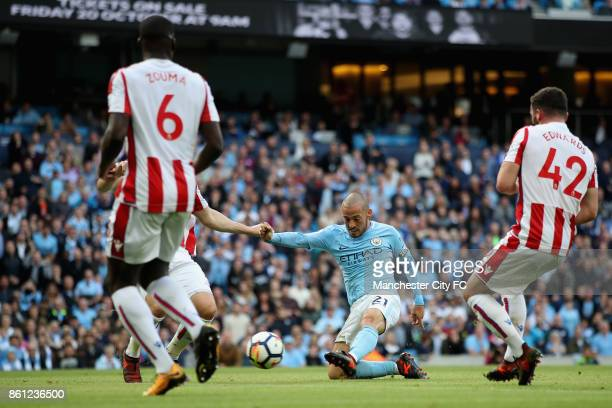 David Silva of Manchester City scores his sides third goal during the Premier League match between Manchester City and Stoke City at Etihad Stadium...