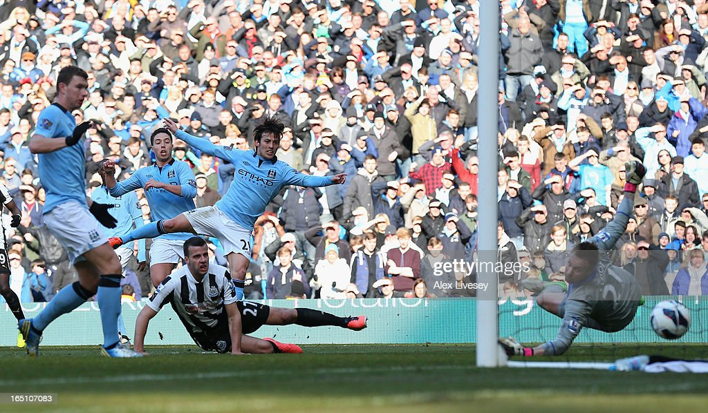 <a gi-track='captionPersonalityLinkClicked' href=/galleries/search?phrase=David+Silva&family=editorial&specificpeople=675795 ng-click='$event.stopPropagation()'>David Silva</a> of Manchester City scores his team's second goal during the Barclays Premier League match between Manchester City and Newcastle United at the Etihad Stadium on March 30, 2013 in Manchester, England.