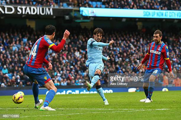 David Silva of Manchester City scores his team's second goal during the Barclays Premier League match between Manchester City and Crystal Palace at...
