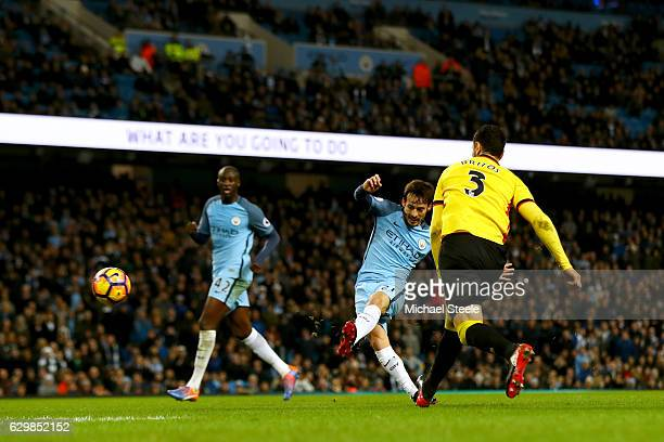 David Silva of Manchester City scores his team's second goal during the Premier League match between Manchester City and Watford at Etihad Stadium on...