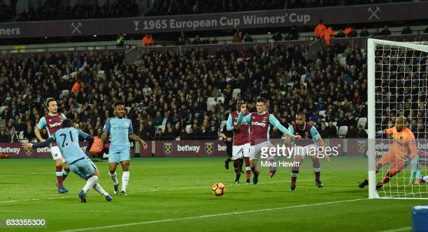 David Silva of Manchester City scores his team's second goal during the Premier League match between West Ham United and Manchester City at London...