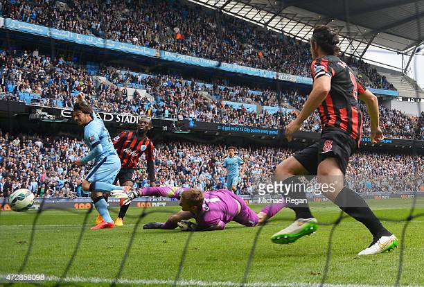 David Silva of Manchester City scores his team's sixth goal past the outstretched Robert Green of QPR during the Barclays Premier League match...
