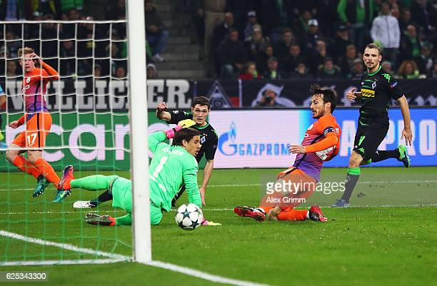 David Silva of Manchester City scores the equaliser on the stroke of half time during the UEFA Champions League match between VfL Borussia...