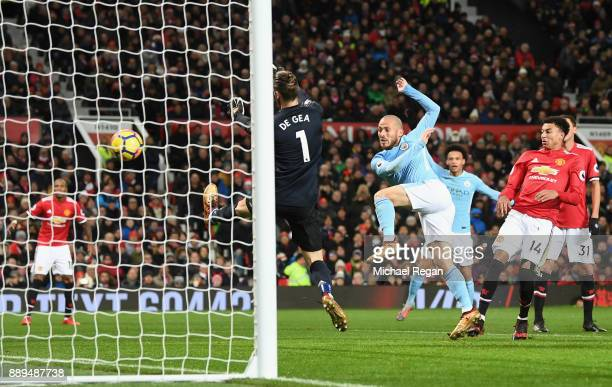 David Silva of Manchester City scores the first Manchester City goal past David De Gea of Manchester United during the Premier League match between...