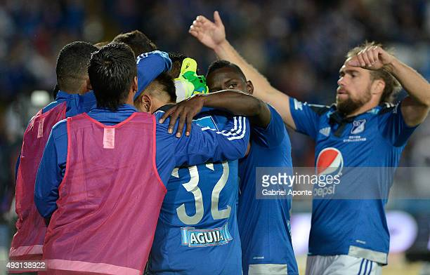 David Silva of Millonarios celebrates with his teammates after scoring the third goal of his team during a match between Millonarios and Jaguares FC...