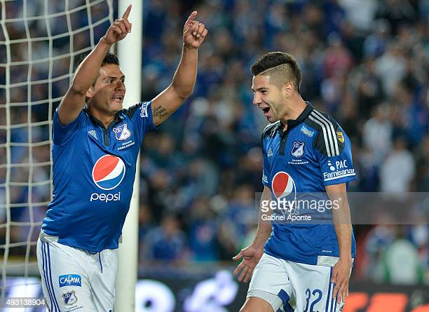 David Silva of Millonarios celebrates with Jonathan Agudelo after scoring the third goal of his team during a match between Millonarios and Jaguares...