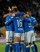 David Silva of Millonarios celebrates with teammates after scoring the opening goal during a match between Millonarios and Once Caldas as part of...