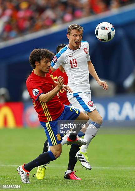 David Silva of Spain and Ladislav Krejci of Czech Republic compete for the ball during the UEFA EURO 2016 Group D match between Spain and Czech...