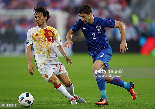 David Silva of Spain and Sime Vrsaljko of Croatia compete for the ball during the UEFA EURO 2016 Group D match between Croatia and Spain at Stade...