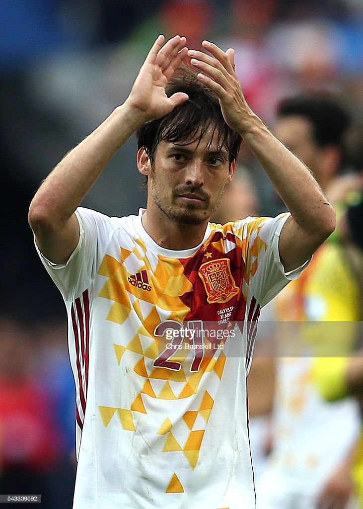<a gi-track='captionPersonalityLinkClicked' href=/galleries/search?phrase=David+Silva&family=editorial&specificpeople=675795 ng-click='$event.stopPropagation()'>David Silva</a> of Spain applauds the supporters at full-time following the UEFA Euro 2016 Round of 16 match between Italy and Spain at Stade de France on June 27, 2016 in Paris, France.