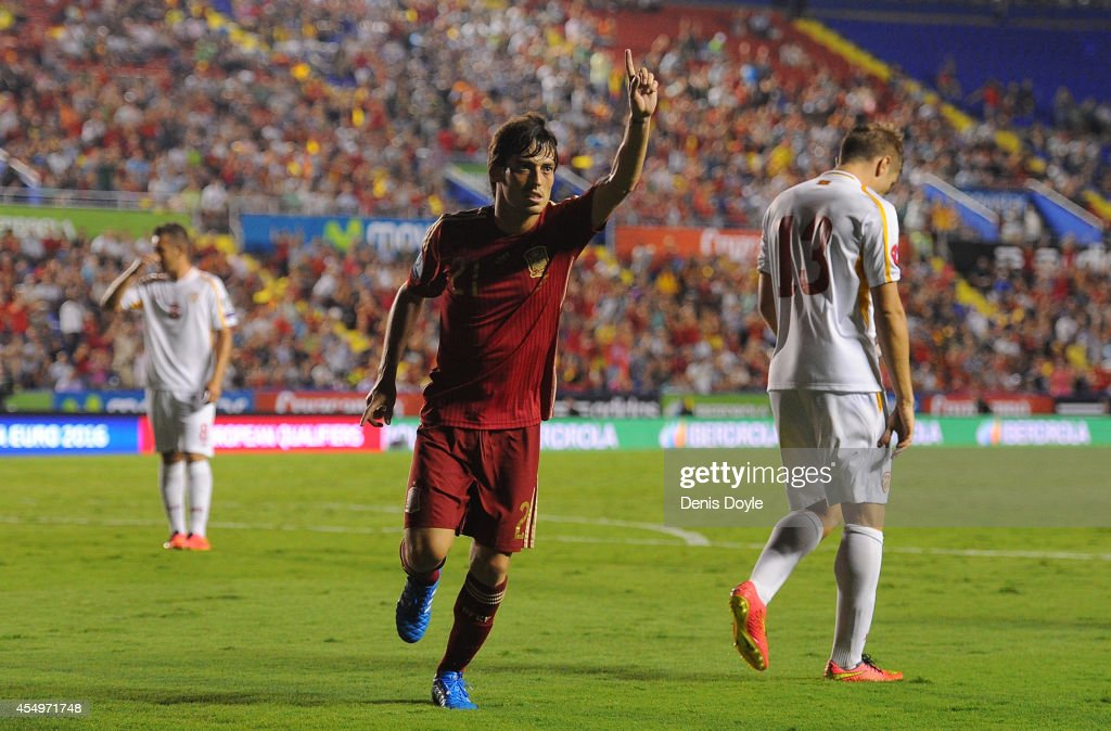 <a gi-track='captionPersonalityLinkClicked' href=/galleries/search?phrase=David+Silva&family=editorial&specificpeople=675795 ng-click='$event.stopPropagation()'>David Silva</a> of Spain celebrates after scoring Spain's 4th goal during the UEFA EURO 2016 Group C Qualifier between Spain and FYR of Macedonia at Estadio Ciutat de Valencia on September 8, 2014 in Valencia, Spain.