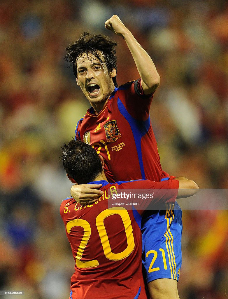 David Silva of Spain celebrates scoring his sides second goal with his teammate Santi Cazorla during the UEFA EURO 2012 Group I Qualifier between...