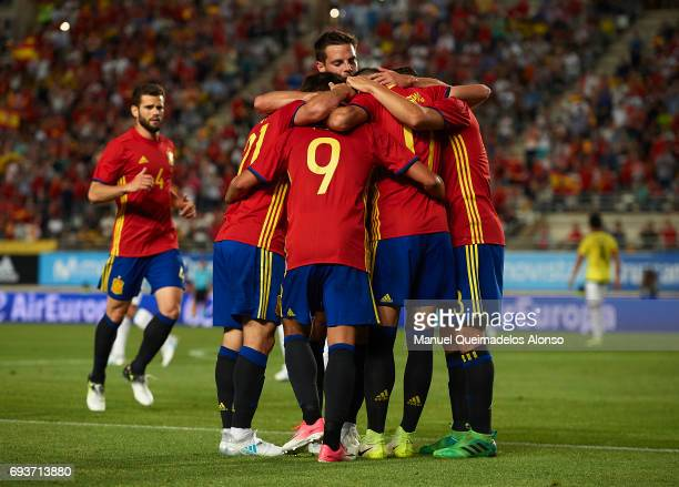 David Silva of Spain celebrates scoring his team's first goal with his teammates during the international friendly match between Spain and Colombia...