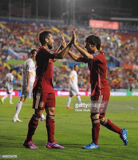David Silva of Spain celebrates with Jordi Alba after scoring Spain's 4th goal during the UEFA EURO 2016 Group C Qualifier between Spain and FYR of...