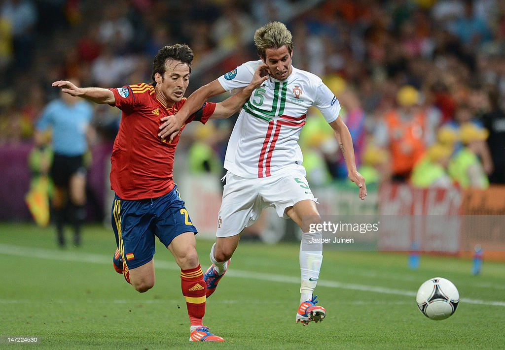 <a gi-track='captionPersonalityLinkClicked' href=/galleries/search?phrase=David+Silva&family=editorial&specificpeople=675795 ng-click='$event.stopPropagation()'>David Silva</a> of Spain challenges Fabio Coentrao of Portugal during the UEFA EURO 2012 semi final match between Portugal and Spain at Donbass Arena on June 27, 2012 in Donetsk, Ukraine.