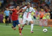 David Silva of Spain challenges Fabio Coentrao of Portugal during the UEFA EURO 2012 semi final match between Portugal and Spain at Donbass Arena on...