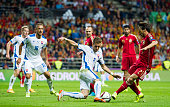 David Silva of Spain duels for the ball with Peter Pekarik of Slovakia during the Spain v Slovakia EURO 2016 Qualifier at Carlos Tartiere on...