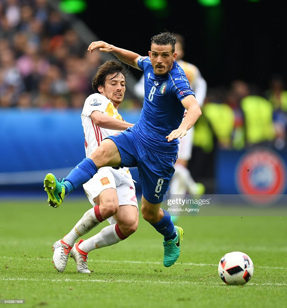 David Silva (L) of Spain in action against Alessandro Florenzi (R) of Italy during the UEFA Euro 2016 round of 16 football match between Italy and Spain at Stade de France in Paris, France on June 27, 2016.