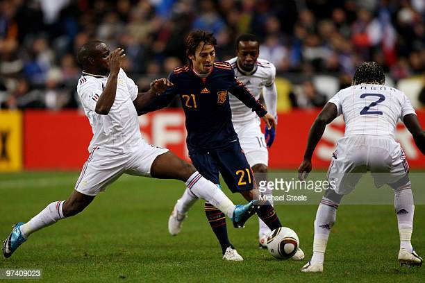 David Silva of Spain is challenged by Lassana Diarra and Bacary Sagna of France during the during the International friendly match betweem France and...