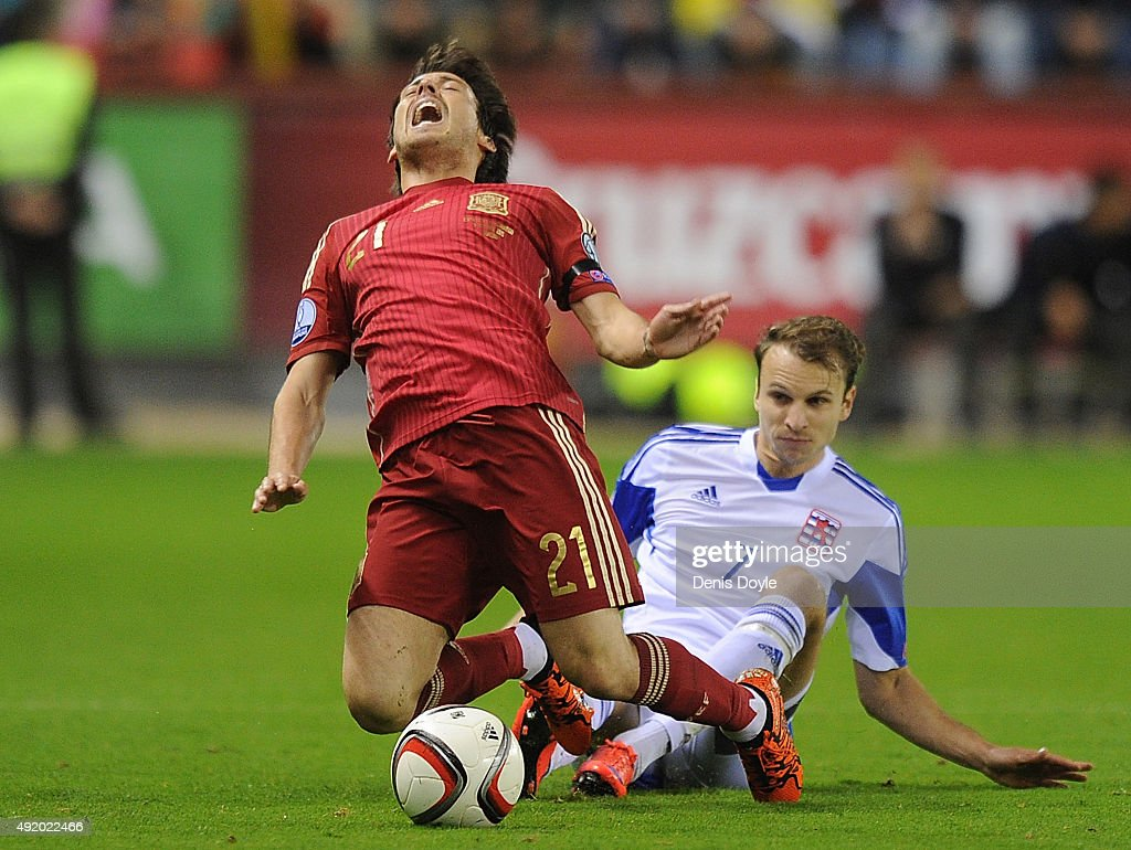 <a gi-track='captionPersonalityLinkClicked' href=/galleries/search?phrase=David+Silva&family=editorial&specificpeople=675795 ng-click='$event.stopPropagation()'>David Silva</a> of Spain is fouled by Lars Gerson of Luxembourg during the UEFA EURO 2016 Qualifier group C match between Spain and Luxembourg at Estadio Municipal Las Gaunas on October 9, 2015 in Logrono, Spain.