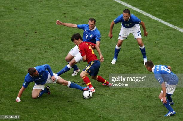 David Silva of Spain is marshalled by Daniele De Rossi Giorgio Chiellini Leonardo Bonucci and Emanuele Giaccherini of Italy during the UEFA EURO 2012...