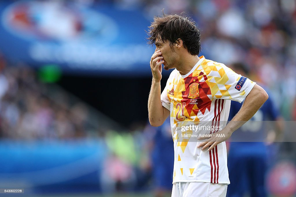 <a gi-track='captionPersonalityLinkClicked' href=/galleries/search?phrase=David+Silva&family=editorial&specificpeople=675795 ng-click='$event.stopPropagation()'>David Silva</a> of Spain reacts during the UEFA Euro 2016 Round of 16 match between Italy and Spain at Stade de France on June 27, 2016 in Paris, France.