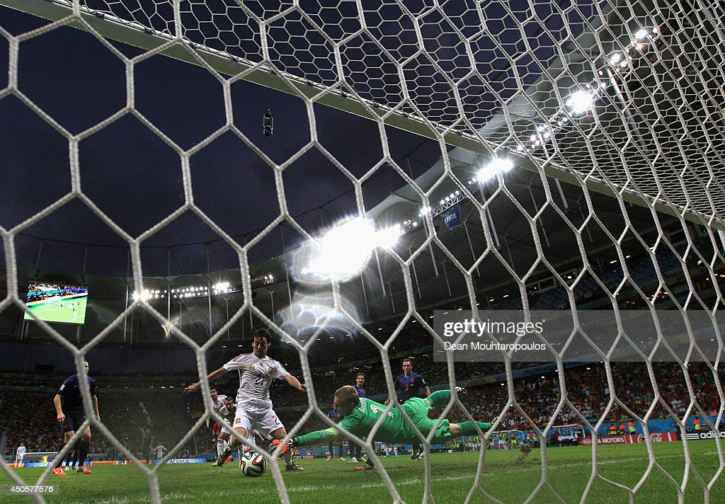 David Silva of Spain scores past Jasper Cillessen of the Netherlands but the goal was disallowed during the 2014 FIFA World Cup Brazil Group B match between Spain and Netherlands at Arena Fonte Nova on June 13, 2014 in Salvador, Brazil.