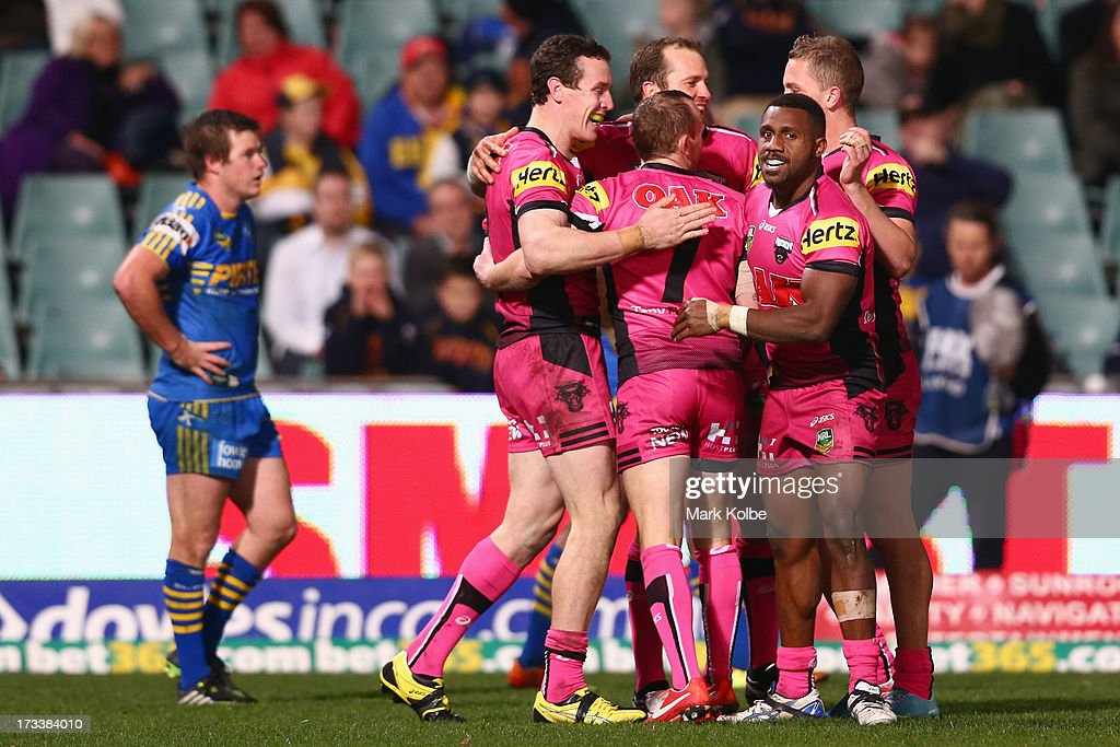 David Simmons of the Panthers celebrates with his team mates after scoring a try during the round 18 NRL match between Parramatta Eels and the Penrith Panthers at Parramatta Stadium on July 13, 2013 in Sydney, Australia.