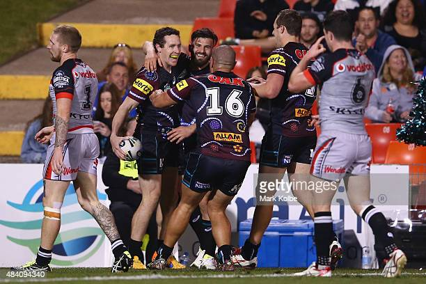 David Simmons of the Panthers celebrates with his team mates after scoring a try during the round 23 NRL match between the Penrith Panthers and the...