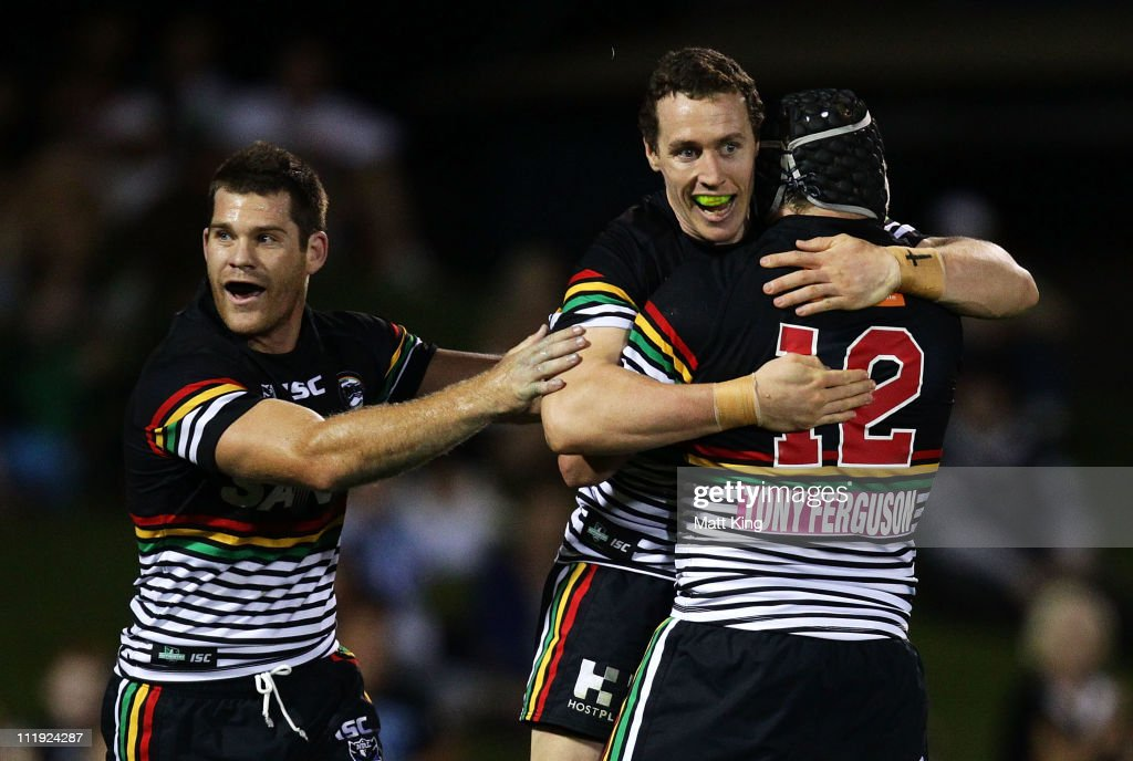 David Simmons (C) of the Panthers celebrates with Kevin Kingston (L) and Nigel Plum (R) after scoring a try during the round five NRL match between the Penrith Panthers and the Canberra Raiders at Centrebet Stadium on April 9, 2011 in Sydney, Australia.