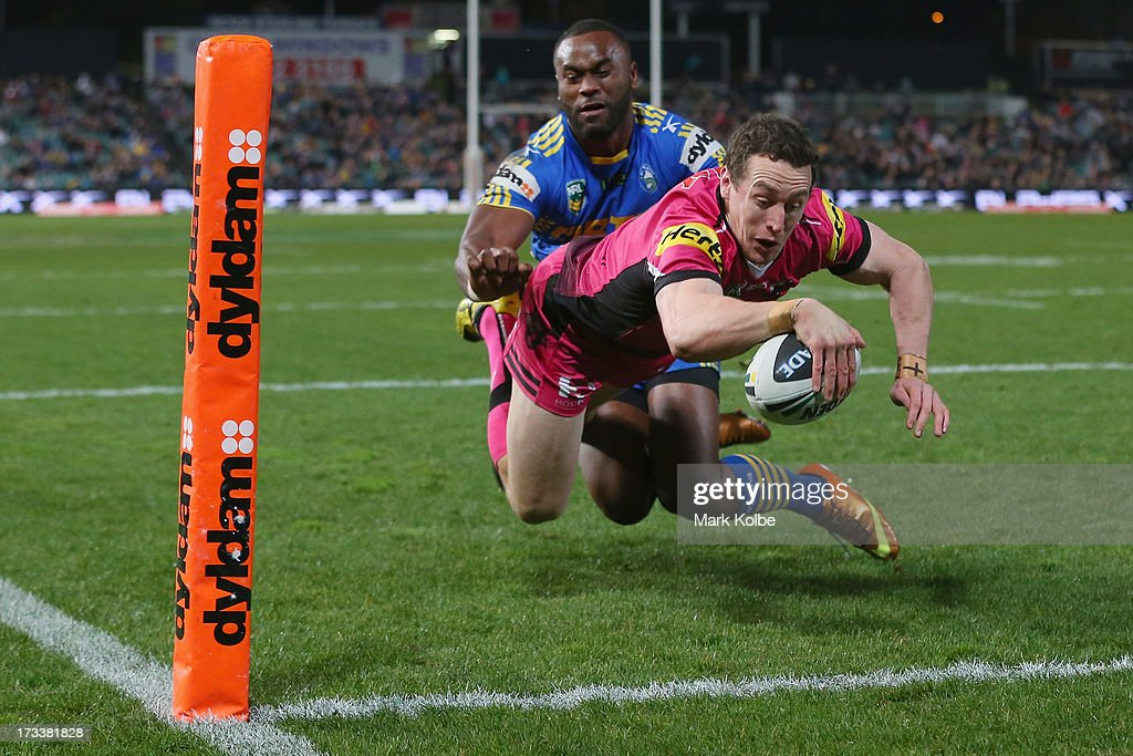David Simmons of the Panthers dives over to score a try during the round 18 NRL match between Parramatta Eels and the Penrith Panthers at Parramatta Stadium on July 13, 2013 in Sydney, Australia.