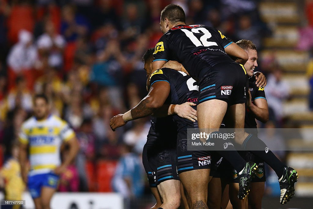 David Simmons of the Panthers is congratulated by his team after scoring a try during the round seven NRL match between the Penrith Panthers and the Parramatta Eels at Centrebet Stadium on April 29, 2013 in Penrith, Australia.