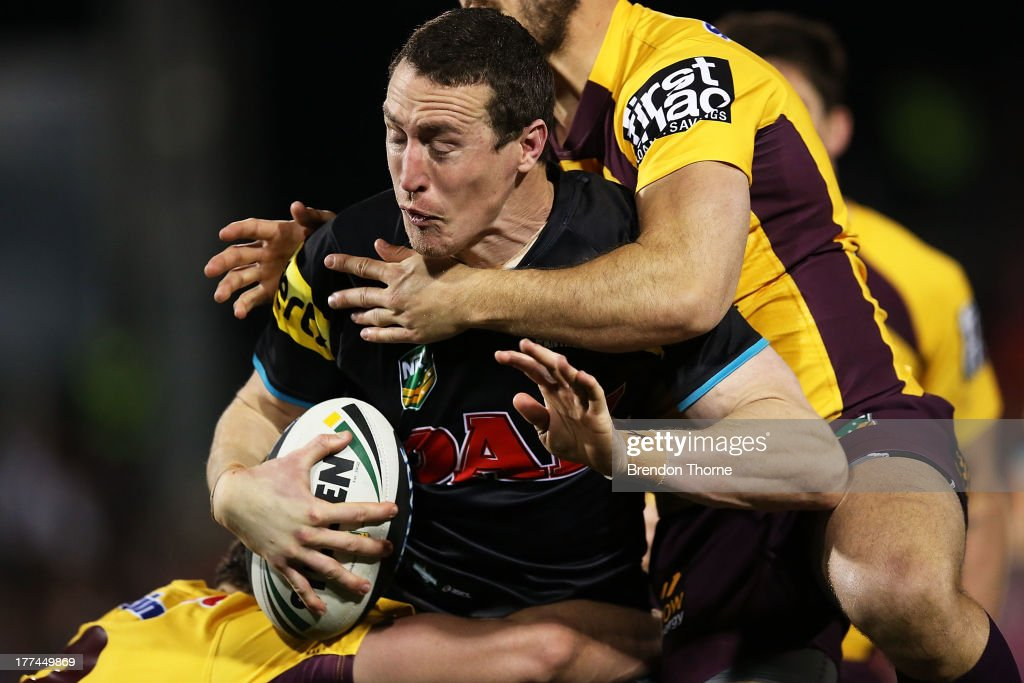 David Simmons of the Panthers is tackled by the Broncos defence during the round 24 NRL match between the Penrith Panthers and the Brisbane Broncos at Centrebet Stadium on August 23, 2013 in Sydney, Australia.