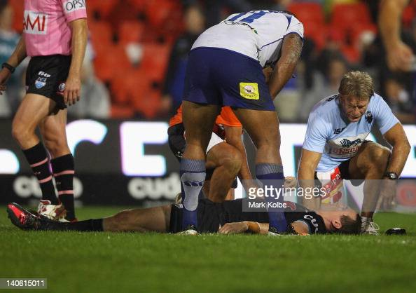 David Simmons of the Panthers lies on the ground after being knocked out during the round one NRL match between the Penrith Panthers and the...