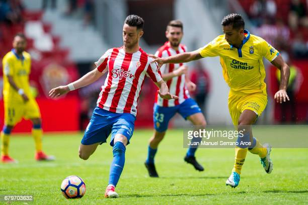 David Simon of UD Las Palmas duels for the ball with Jorge Franco 'Burgui' of Real Sporting de Gijon during the La Liga match between Real Sporting...
