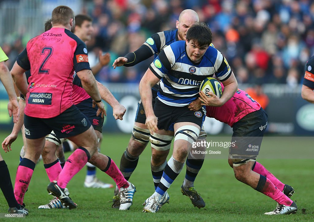 David Sisi (C) of Bath runs at James Down (R) of Cardiff Blues during the LV Cup match between Bath and Cardiff Blues at the Recreation Ground on January 25, 2014 in Bath, England.