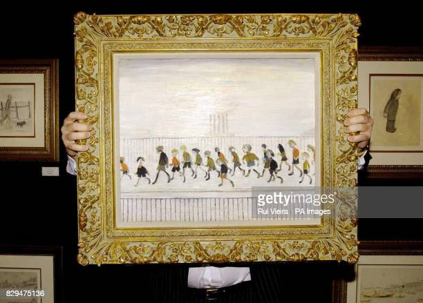 David Smith Managing Director for Neptune Fine Art Ltd holds LS Lowry's 'Children Running' A collection of thirteen pieces by the British painter...