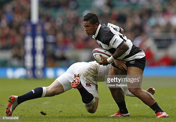David Smith of the Barbarians evades the tackle of Elliot Wade of England during the match between the Barbarians and England XV at Twickenham...