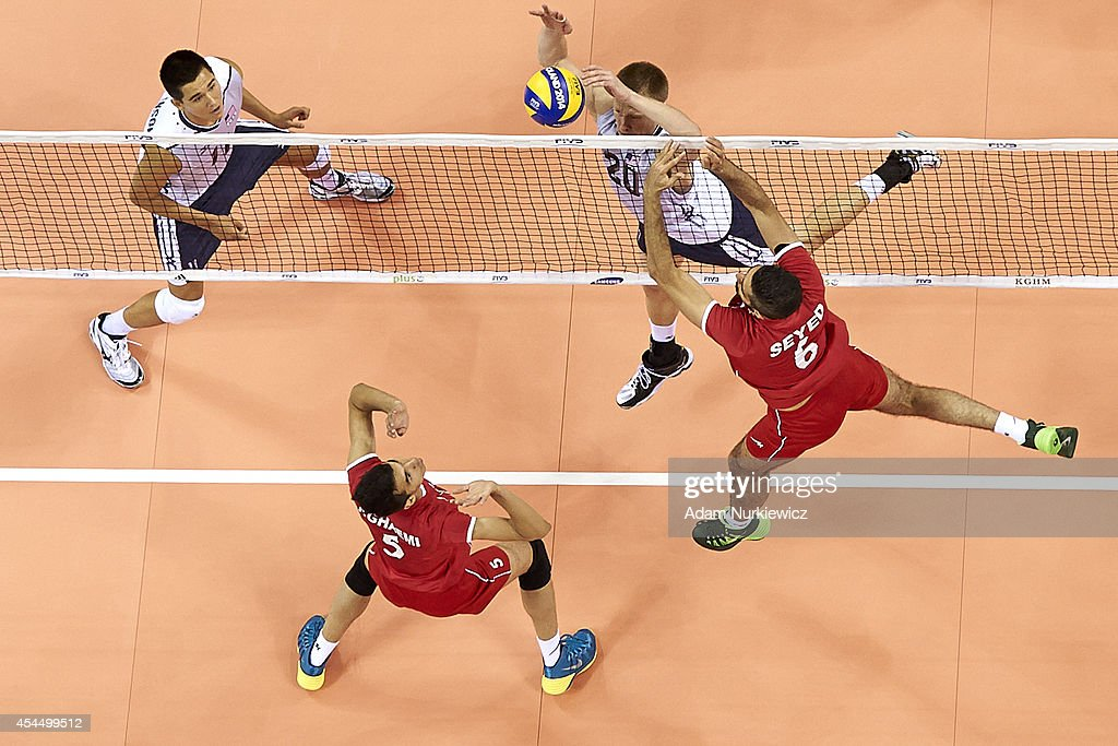 David Smith of USA and Iran's Seyed Mohammad Mousavi Eraghi fight for the ball on the net during the FIVB World Championships match between USA and Iran at Cracow Arena on September 2, 2014 in Cracow, Poland.