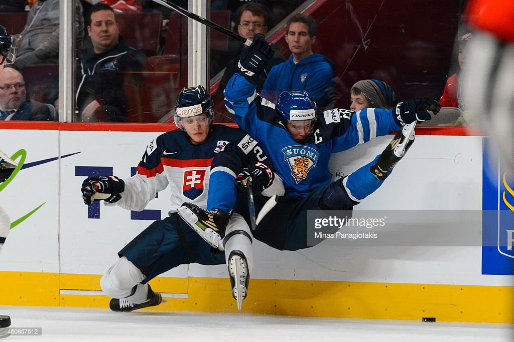 David Soltes #21 of Team Slovakia checks <a gi-track='captionPersonalityLinkClicked' href=/galleries/search?phrase=Artturi+Lehkonen&family=editorial&specificpeople=9619074 ng-click='$event.stopPropagation()'>Artturi Lehkonen</a> #28 of Team Finland during the 2015 IIHF World Junior Hockey Championship game at the Bell Centre on December 27, 2014 in Montreal, Quebec, Canada.