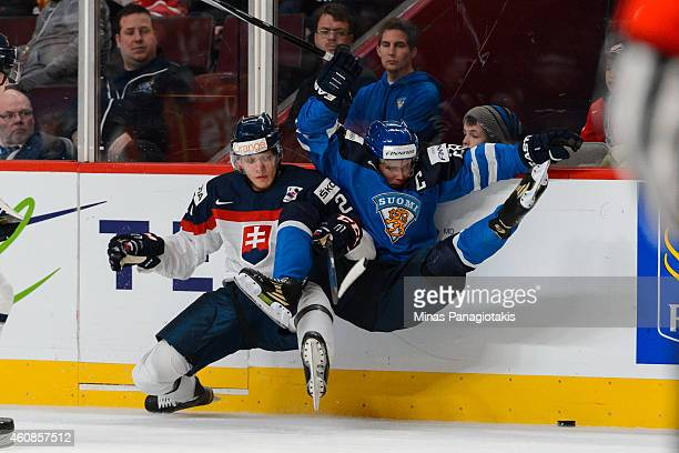 David Soltes of Team Slovakia checks Artturi Lehkonen of Team Finland during the 2015 IIHF World Junior Hockey Championship game at the Bell Centre...