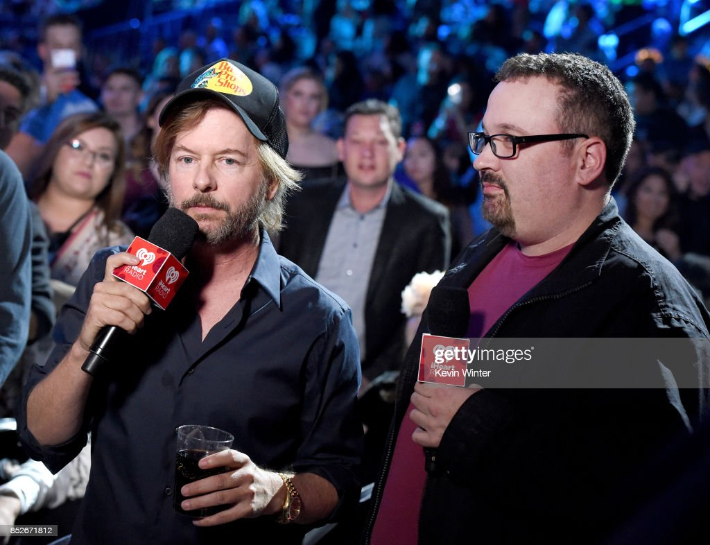 David Spade (L) and Woody speak onstage during the 2017 iHeartRadio Music Festival at T-Mobile Arena on September 23, 2017 in Las Vegas, Nevada.