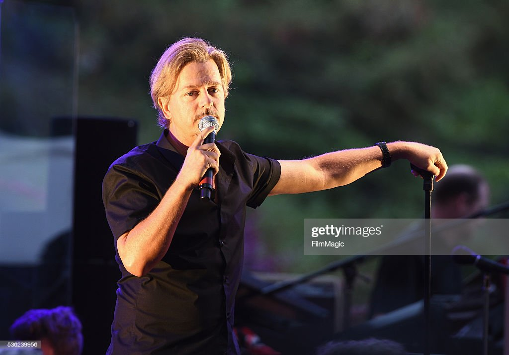 <a gi-track='captionPersonalityLinkClicked' href=/galleries/search?phrase=David+Spade&family=editorial&specificpeople=209074 ng-click='$event.stopPropagation()'>David Spade</a> performs onstage at WHO Cares About The Next Generation at a private residence on May 31, 2016 in Pacific Palisades, California.