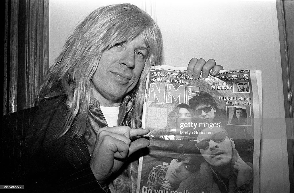 David St Hubbins of Spinal Tap poses holding a copy of music magazine NME featuring the Manic Street Preachers on the cover London United Kingdom 1992