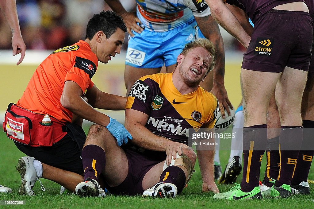 David Stagg of the Broncos receives attention on the field during the round 10 NRL match between the Brisbane Broncos and the Gold Coast Titans at Suncorp Stadium on May 17, 2013 in Brisbane, Australia.