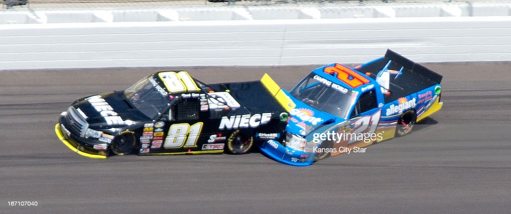 David Starr (81) and Spencer Gallagher (21) collide during the NASCAR Camping World Truck Series' SPF 250 on Saturday, April 20, 2013, at Kansas Speedway in Kansas City, Kansas.