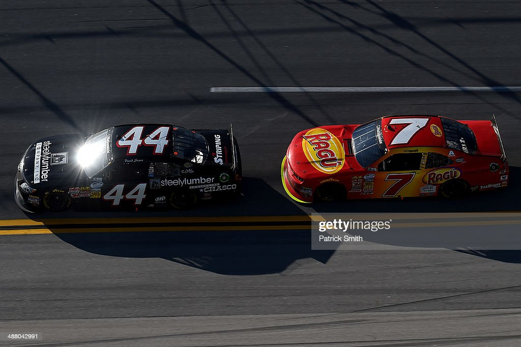 David Starr driver of the BYForg / Steely Lumber Company Toyota leads Regan Smith driver of the Ragu Chevrolet during the NASCAR Nationwide Series...